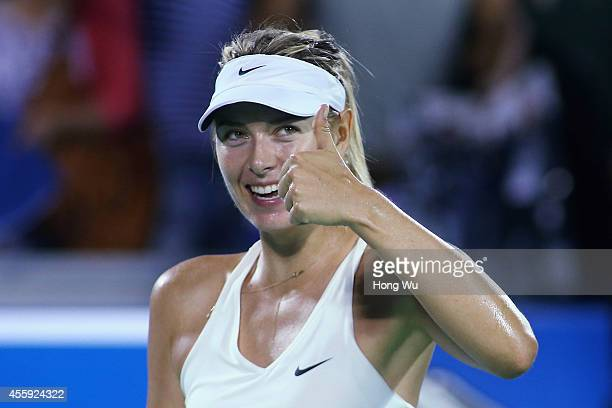 Maria Sharapova of Russia reacts after won her match against Svetlana Kuznetsova of Russia during day two of the 2014 Dongfeng Motor Wuhan Open at...