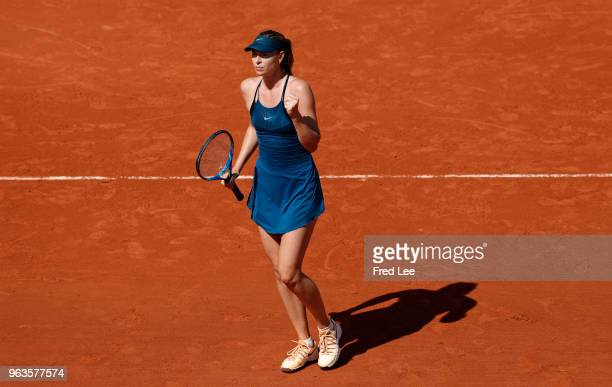Maria Sharapova of Russia reacts during the ladies singles first round match against Richel Hogenkamp of the Netherlands during day three of the 2018...
