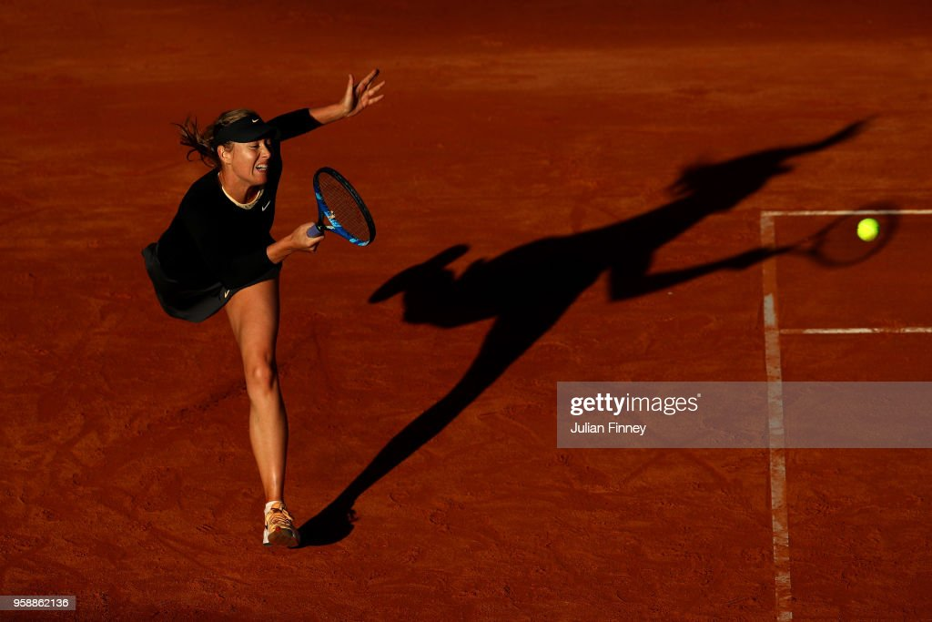 Maria Sharapova of Russia returns a serve in her match against Ashleigh Barty of Australia during day three of the Internazionali BNL d'Italia 2018 tennis at Foro Italico on May 15, 2018 in Rome, Italy.