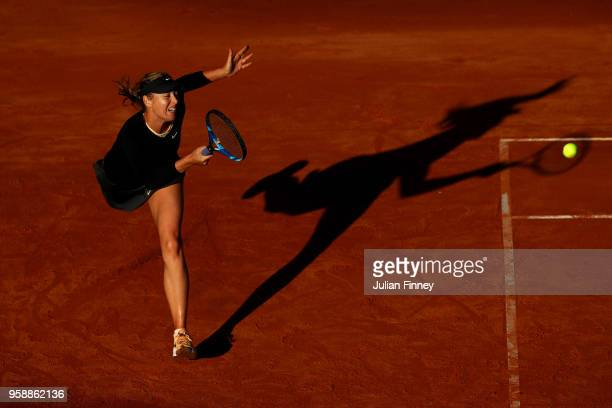 Maria Sharapova of Russia returns a serve in her match against Ashleigh Barty of Australia during day three of the Internazionali BNL d'Italia 2018...