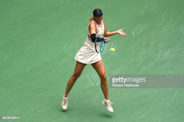 Maria Sharapova of Russia returns a shot against Anastasija Sevastova of Latvia during their Women's Singles fourth round match on Day Seven of the...