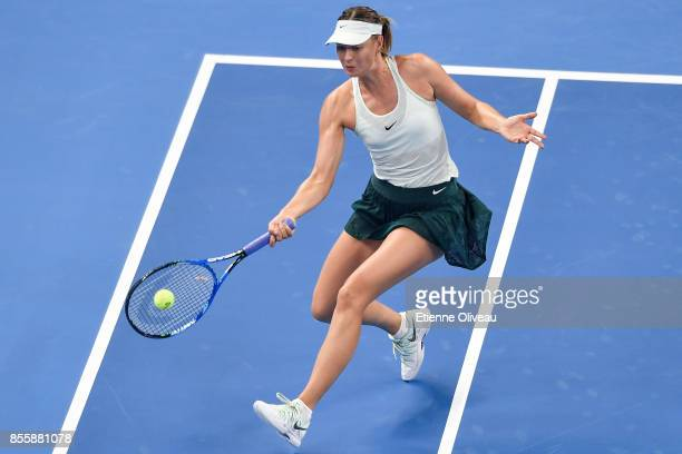 Maria Sharapova of Russia returns a shot against Anastasija Sevastova of Latvia during their first round match on day one of the 2017 China Open at...