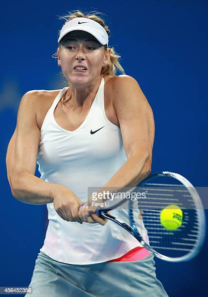 Maria Sharapova of Russia returns a shot against Carla Suarez Navarro of Spain during day five of the China Open at the China National Tennis Center...