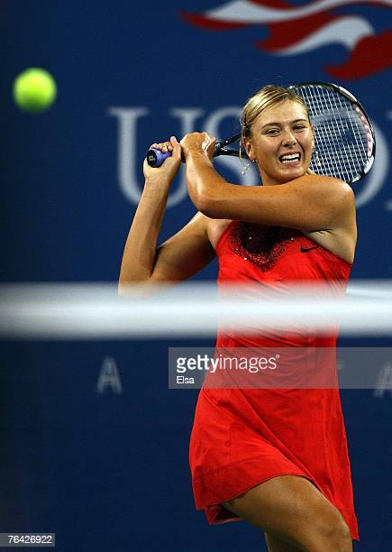 Maria Sharapova of Russia returns a shot against Casey Dellacqua of Australia during day four of the 2007 US Open at the Billie Jean King National...