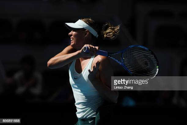Maria Sharapova of Russia returns a shot against Ekaterina Makarova of Russia during the women's singles first round on day four of 2017 China Open...