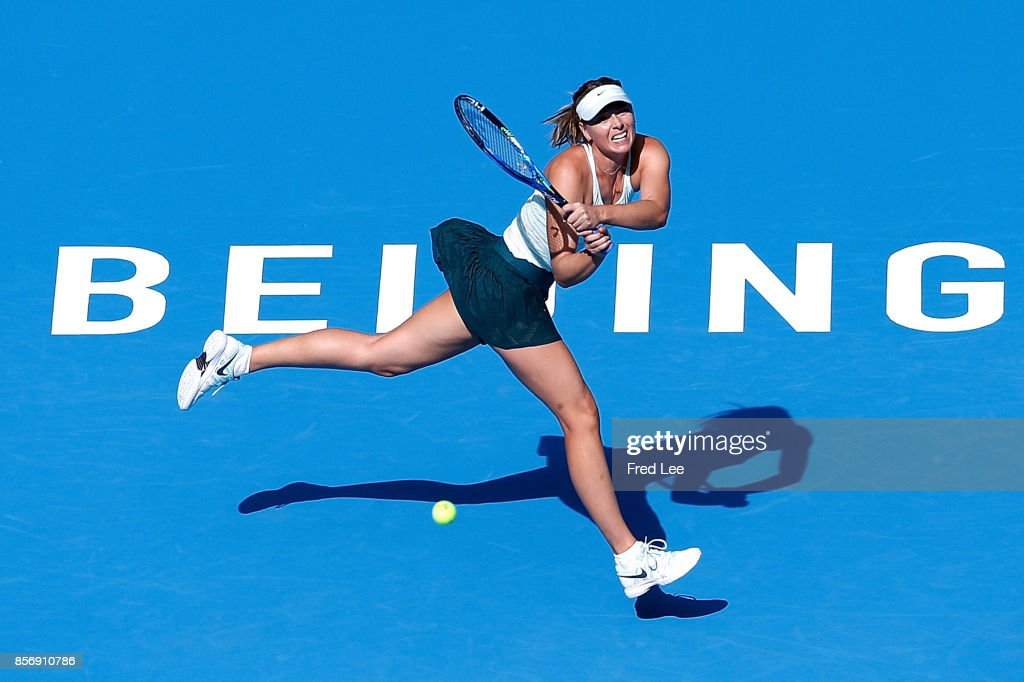 Maria Sharapova of Russia returns a shot against Ekaterina Makarova of Russia during the women's singles second round on day four of 2017 China Open at the China National Tennis Centre on October 3, 2017 in Beijing, China.