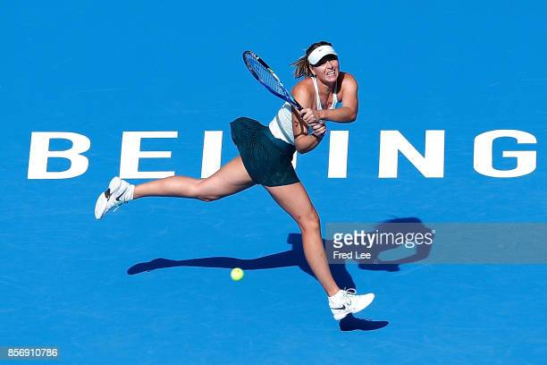 Maria Sharapova of Russia returns a shot against Ekaterina Makarova of Russia during the women's singles second round on day four of 2017 China Open...