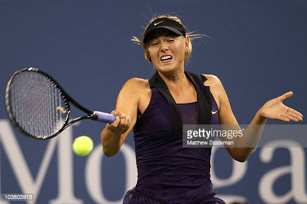 Maria Sharapova of Russia returns a shot against Iveta Benesova of the Czech Republic during day four of the 2010 U.S. Open at the USTA Billie Jean...