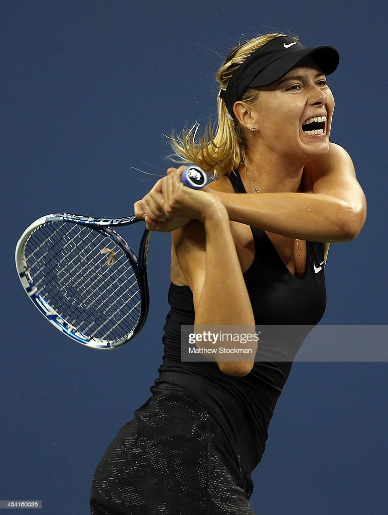 Maria Sharapova of Russia returns a shot against Maria Kirilenko of Russia during her women's singles first round match on Day One of the 2014 US Open at the USTA Billie Jean King National Tennis Center on August 25, 2014 in the Flushing neighborhood of the Queens borough of New York City.