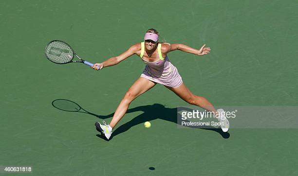 Maria Sharapova of Russia returns a shot against Melanie Oudin of the United States during her match against during day six of the 2009 US Open at...