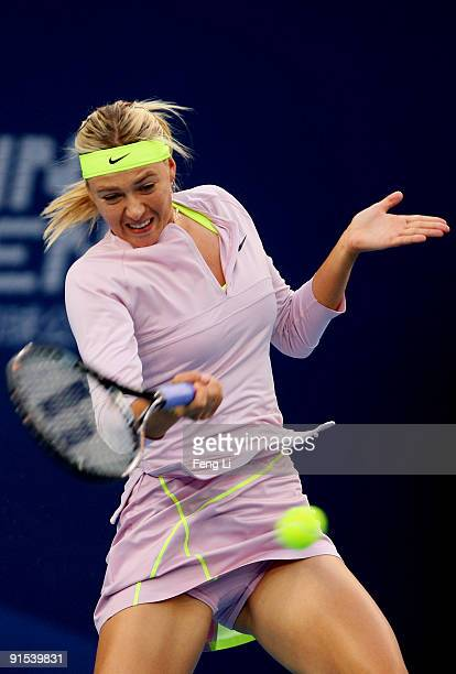 Maria Sharapova of Russia returns a shot against Peng Shuai of China in her third round match during day six of the 2009 China Open at the National...