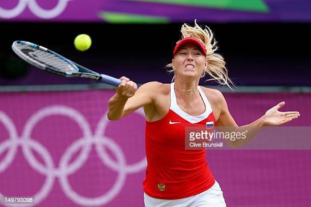 Maria Sharapova of Russia returns a shot against Serena Williams of the United States of America during the gold medal match of the Women's Singles...