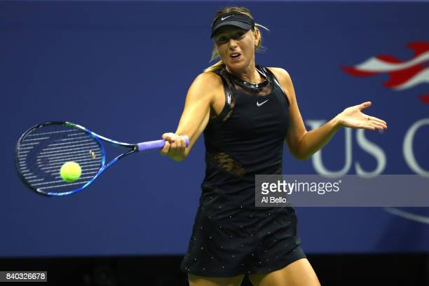 Maria Sharapova of Russia returns a shot against Simona Halep of Romania during her first round Women's Singles match on Day One of the 2017 US Open...