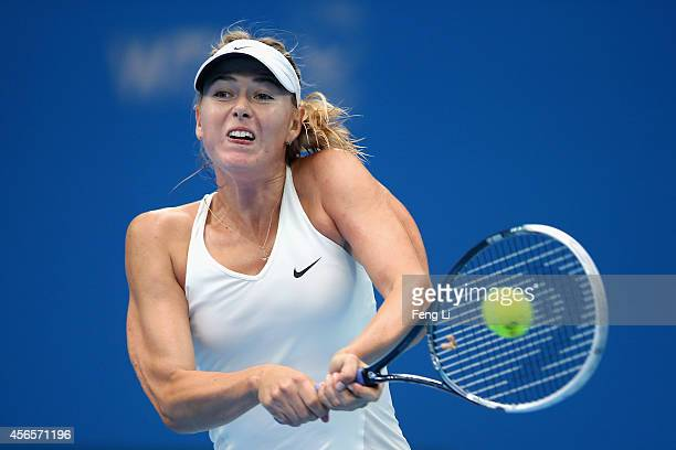 Maria Sharapova of Russia returns a shot against Svetlana Kuznetsova of Russia during day seven of the China Open at the National Tennis Center on...