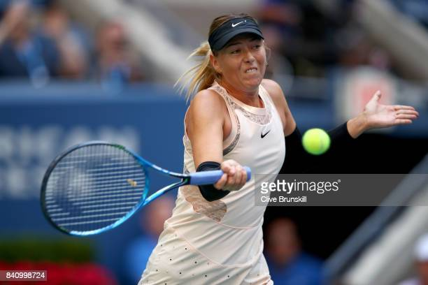 Maria Sharapova of Russia returns a shot against Timea Babos of Hungary during their second round Women's Singles match on Day Three of the 2017 US...