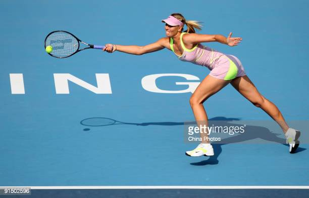 Maria Sharapova of Russia returns a shot against Victoria Azarenka of Belarus in her first round match during day five of the 2009 China Open at the...