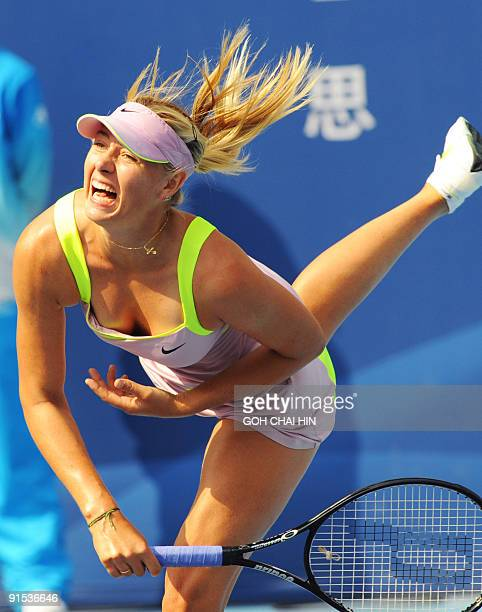 Maria Sharapova of Russia returns a shot against Victoria Azarenka of Belarus during the second round match at the China Open 2009 in Beijing on...