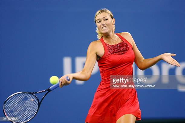 Maria Sharapova of Russia returns a shot during her 2007 US Open match against Roberta Vinci of Italy in Arthur Ashe Stadium at the Billie Jean King...