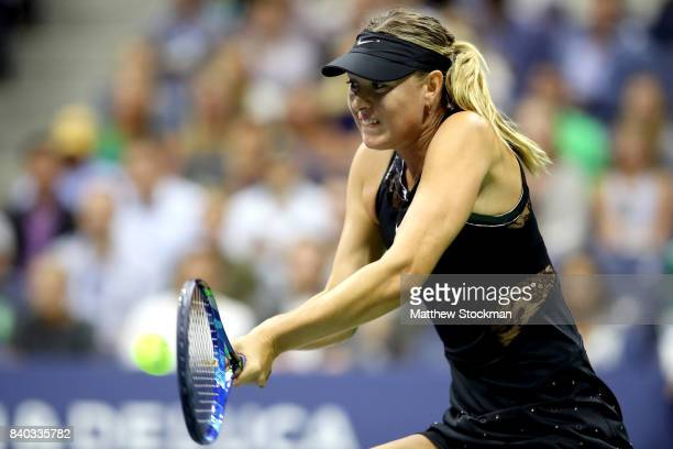 Maria Sharapova of Russia returns a shot during her first round Women's Singles match against Simona Halep of Romania on Day One of the 2017 US Open...
