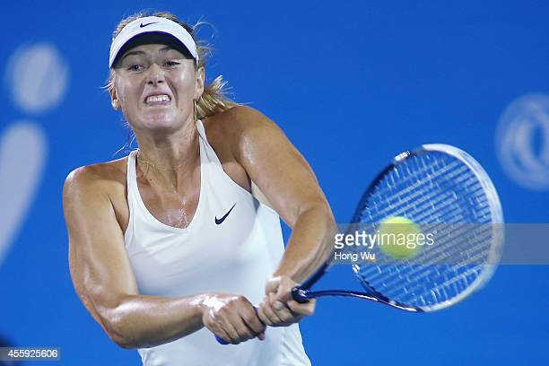 Maria Sharapova of Russia returns a shot during her match against Svetlana Kuznetsova of Russia during day two of the 2014 Dongfeng Motor Wuhan Open...