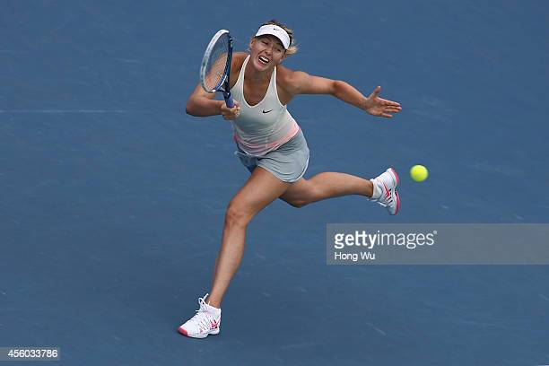 Maria Sharapova of Russia returns a shot during her match against Timea Bacsinszky of Switzerland on day four of 2014 Dongfeng Motor Wuhan Open at...