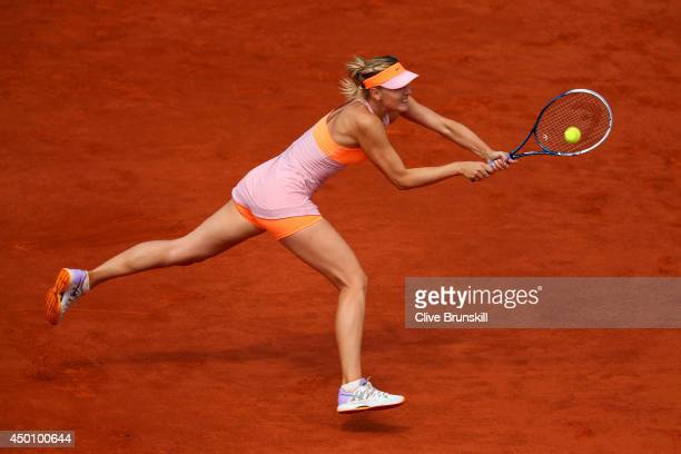 Maria Sharapova of Russia returns a shot during her women's singles semi-final match against Eugenie Bouchard of Canada on day twelve of the French...