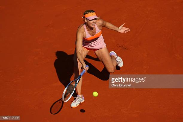 Maria Sharapova of Russia returns a shot during her women's singles semifinal match against Eugenie Bouchard of Canada on day twelve of the French...