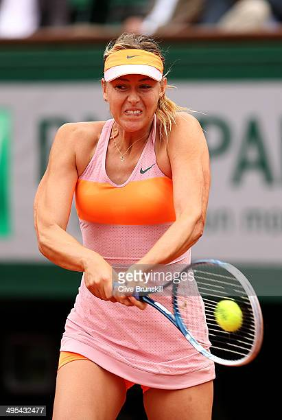 Maria Sharapova of Russia returns a shot during her women's singles quarterfinal match against Garbine Muguruza of Spain on day ten of the French...
