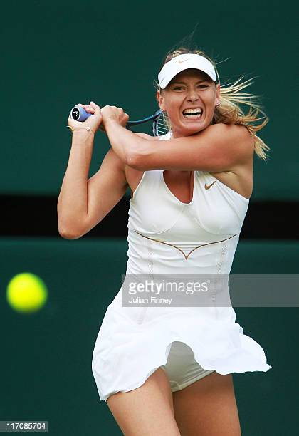 Maria Sharapova of Russia returns a shot during she first round match against Anna Chakvetadze of Russia on Day Two of the Wimbledon Lawn Tennis...