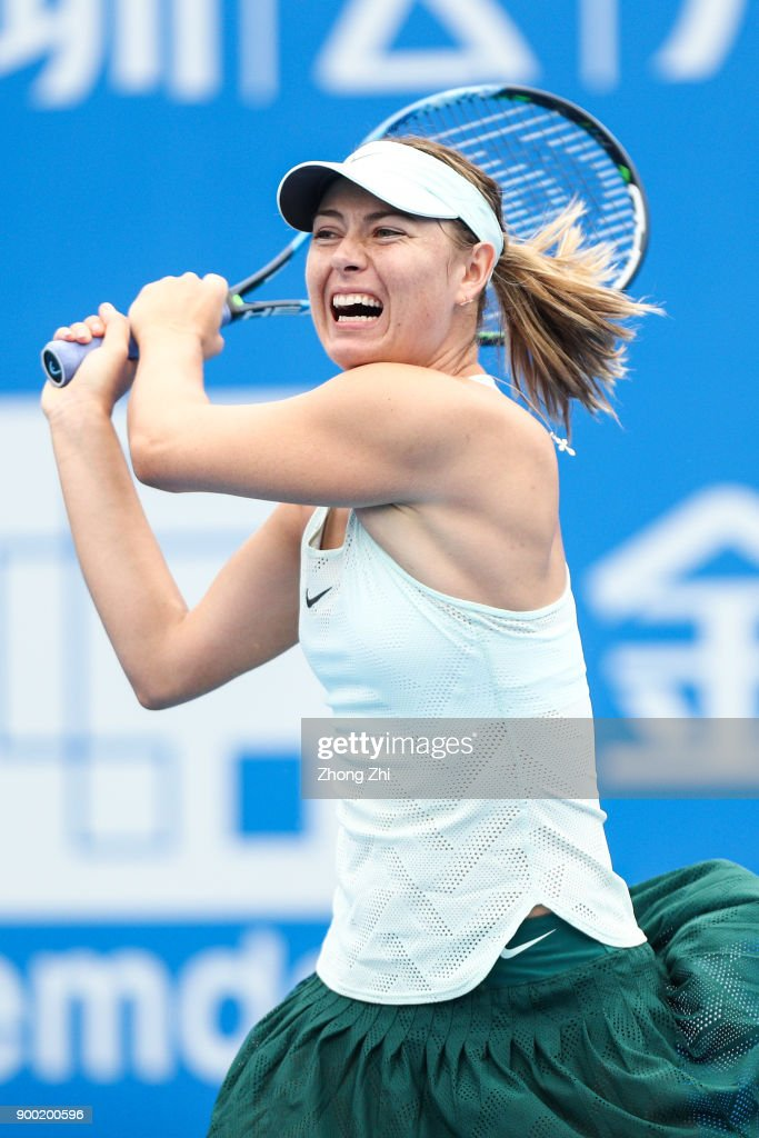 Maria Sharapova of Russia returns a shot during the match against Mihaela Buzarnescu of Romania during Day 2 of 2018 WTA Shenzhen Open at Longgang International Tennis Center on January 1, 2018 in Shenzhen, China.