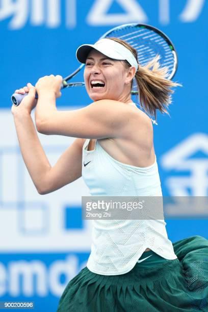 Maria Sharapova of Russia returns a shot during the match against Mihaela Buzarnescu of Romania during Day 2 of 2018 WTA Shenzhen Open at Longgang...