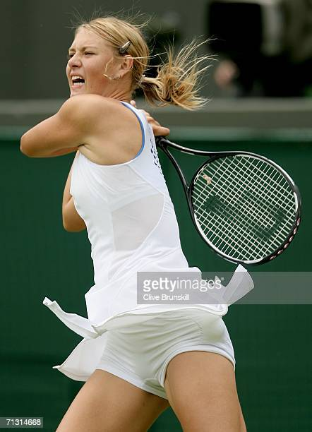 Maria Sharapova of Russia returns a shot to Anna Smashnova of Israel during day three of the Wimbledon Lawn Tennis Championships at the All England...