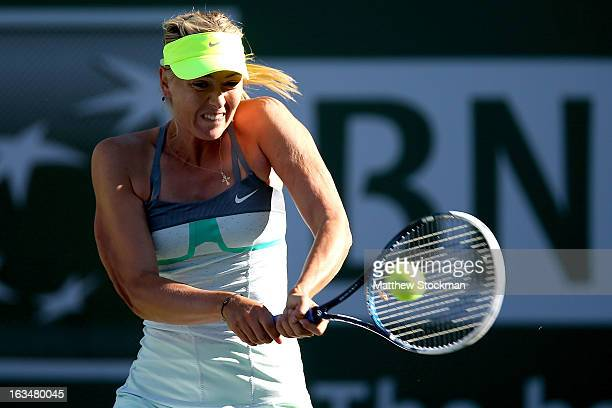 Maria Sharapova of Russia returns a shot to Carla Suarez Navarro of Spain during the BNP Paribas Open at the Indian Wells Tennis Garden on March 10,...