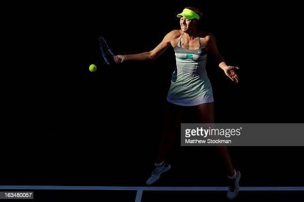 Maria Sharapova of Russia returns a shot to Carla Suarez Navarro of Spain during the BNP Paribas Open at the Indian Wells Tennis Garden on March 10...
