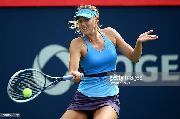 Maria Sharapova of Russia returns a shot to Garbine Muguruza of Spain during the Rogers Cup at Uniprix Stadium on August 6 2014 in Montreal Canada