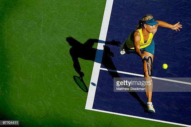 Maria Sharapova of Russia returns a shot to Jie Zheng of China during the BNP Paribas Open on March 14 2010 in Indian Wells California