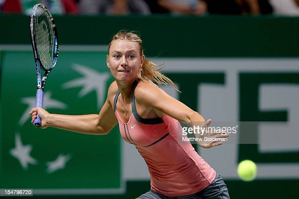 Maria Sharapova of Russia returns a shot to Samantha Stosur of Australia in round robin play during the TEB BNP Paribas WTA Championships at the...