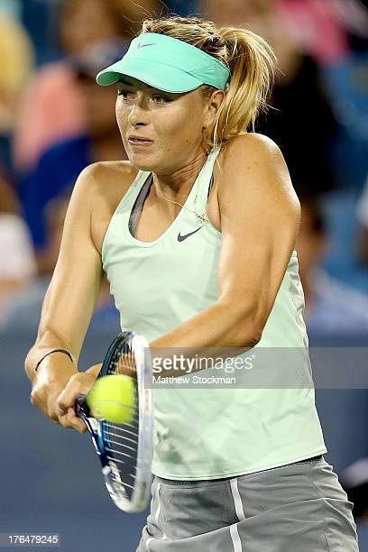 Maria Sharapova of Russia returns a shot to Sloane Stephens during the Western & Southern Open on August 13, 2013 at Lindner Family Tennis Center in...