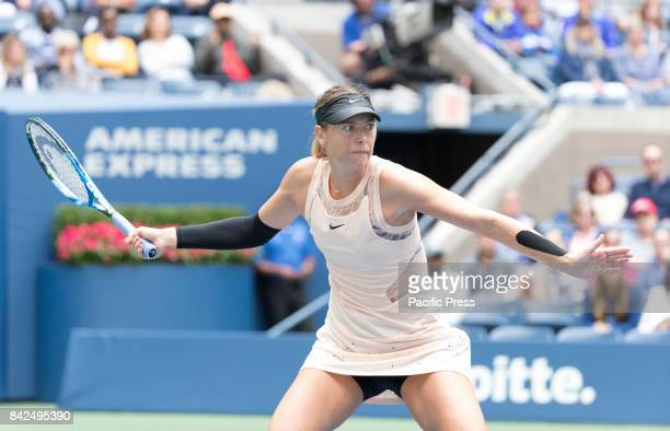 Maria Sharapova of Russia returns ball during match against Anastasija Sevastova of Latvia at US Open Championships at Billie Jean King National...