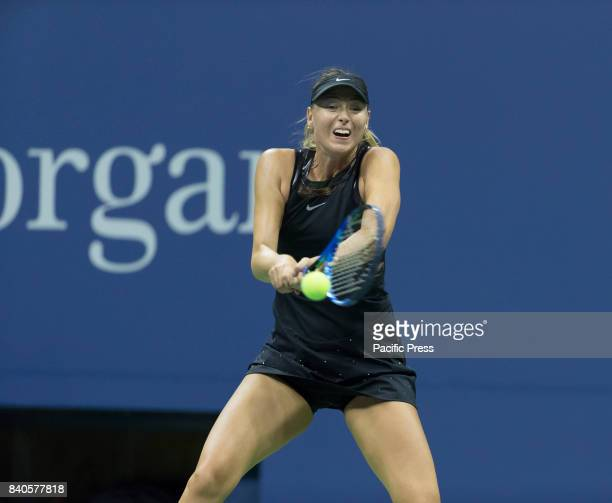 Maria Sharapova of Russia returns ball during US Open Championships day match against Simona Halep of Romania at Billie Jean King Tennis center