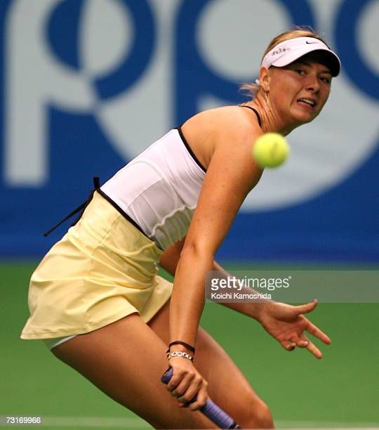 Maria Sharapova of Russia returns the ball against Francesca Schiavone of Italy during day three of the Toray Pan Pacific Tournament at the Tokyo...