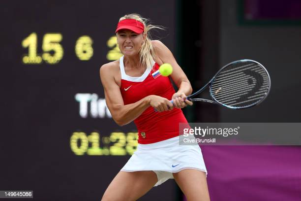 Maria Sharapova of Russia returns the ball against Sabine Lisicki of Germany during the third round of Women's Singles Tennis on Day 5 of the London...