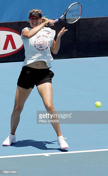 Maria Sharapova of Russia returns the ball during a practice session in the leadup for the Australian Open in Melbourne 09 January 2008 Sharapova...