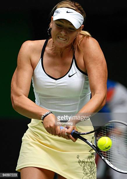 Maria Sharapova of Russia returns the ball to fellow Russian Anna Chakvetadze not seen at the Australian Open Tennis Championships in Melbourne on...