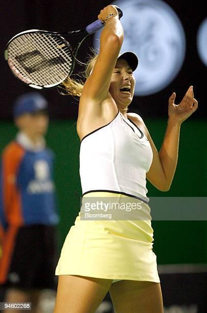 Maria Sharapova of Russia returns the ball to Vera Zvonareva of Russia at the Australian Open Tennis Championships in Melbourne Australia Monday Jan...
