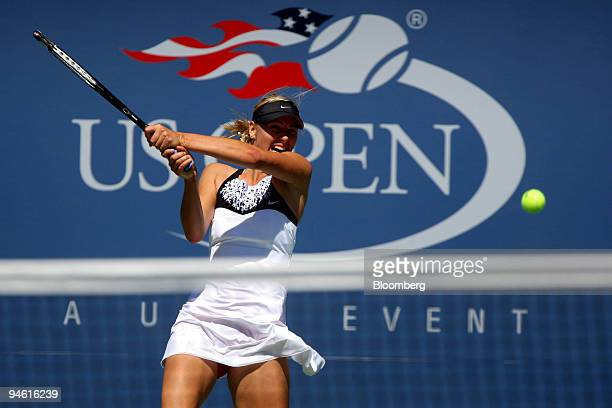 Maria Sharapova of Russia returns to Agnieszka Radwanska of Poland during their third round match on the sixth day of the US Open at the Billie Jean...