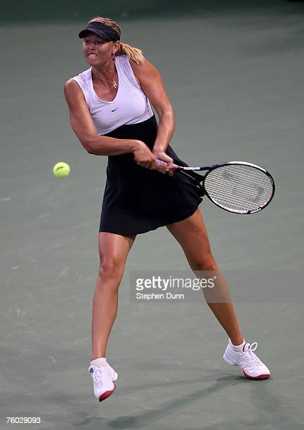 Maria Sharapova of Russia returns to Eleni Daniilidou of Germany during day three of the East West Bank Classic at the Home Depot Center on August 8...