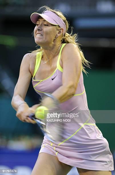Maria Sharapova of Russia returns to Iveta Benesova of the Czech Republic during their women's singles quarterfinal match in the Pan Pacific Open...