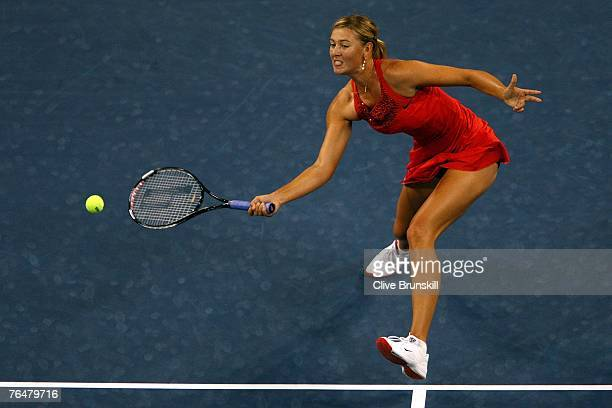 Maria Sharapova of Russia returns to Roberta Vinci of Italy during day two of the 2007 US Open at the Billie Jean King National Tennis Center on...