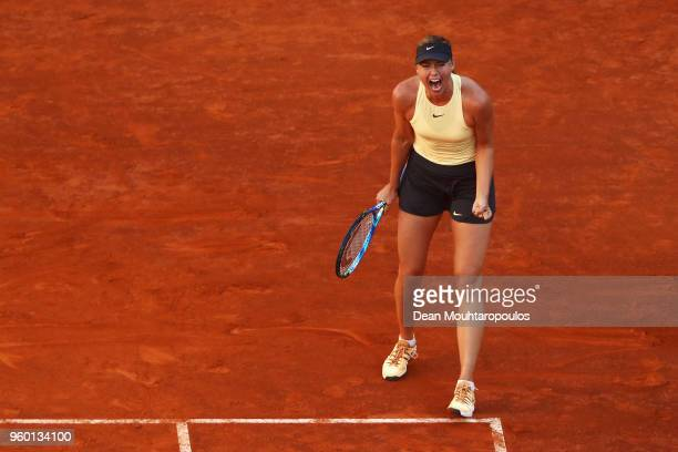 Maria Sharapova of Russia screams after winning a point in her semi final match against Simona Halep of Romania during day 7 of the Internazionali...